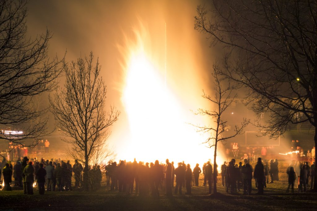 Big huge traditional fire. Burning of witches in a bonfire. Profane rites in Bavaria, Germany. Alps.